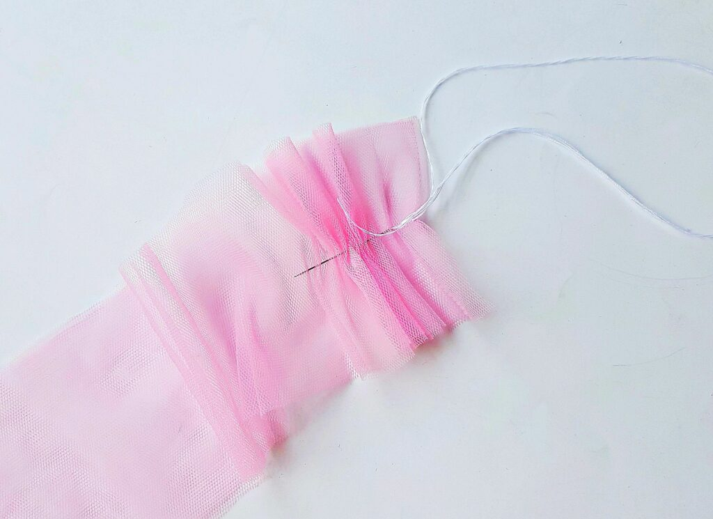 running thread with needle pink mesh tulle