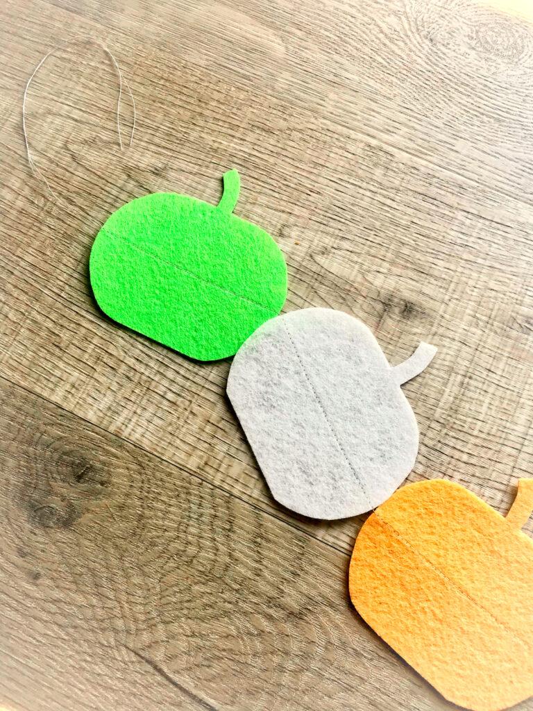 felt pumpkin shapes stitched together