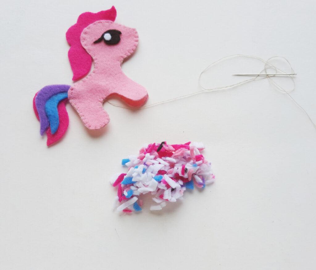 tiny felt scraps next to my little pony craft for kids