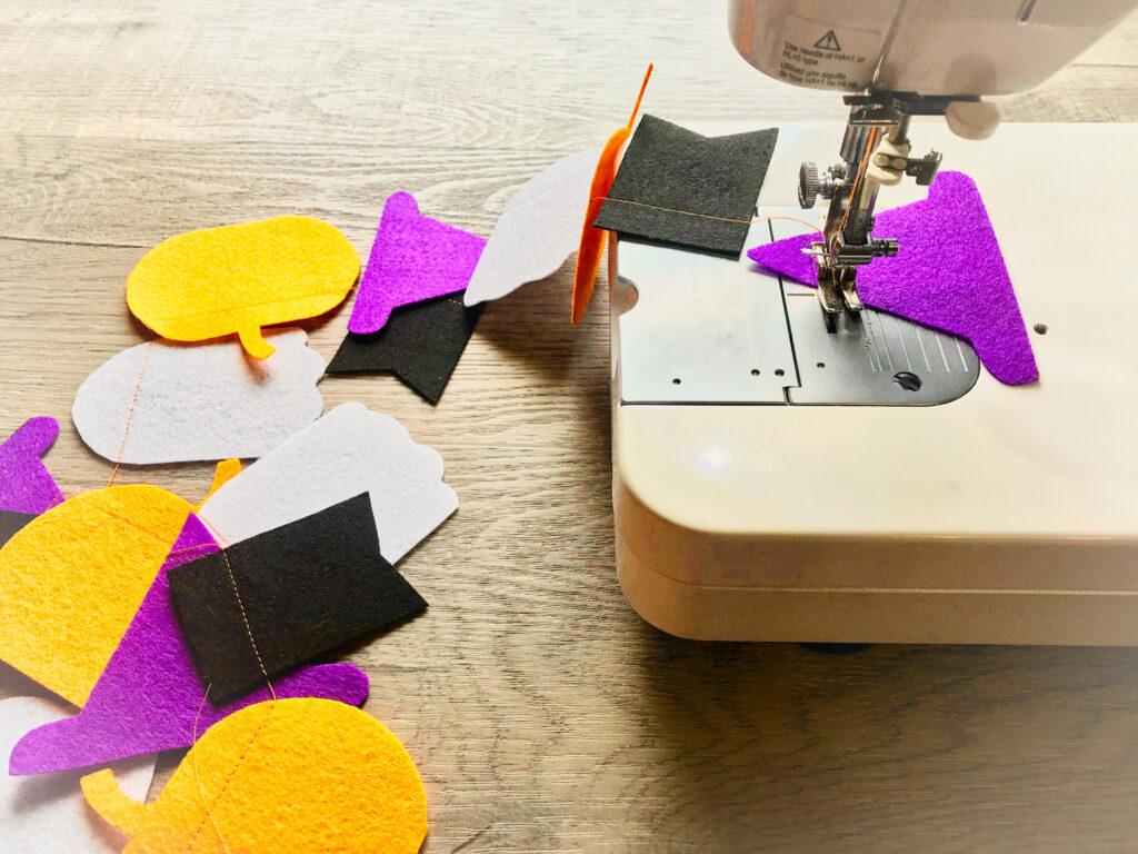 felt garland being sewn