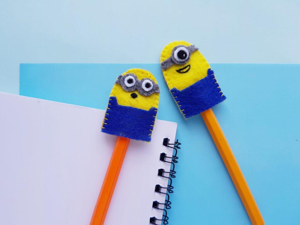 felt minion crafts on top of pencils