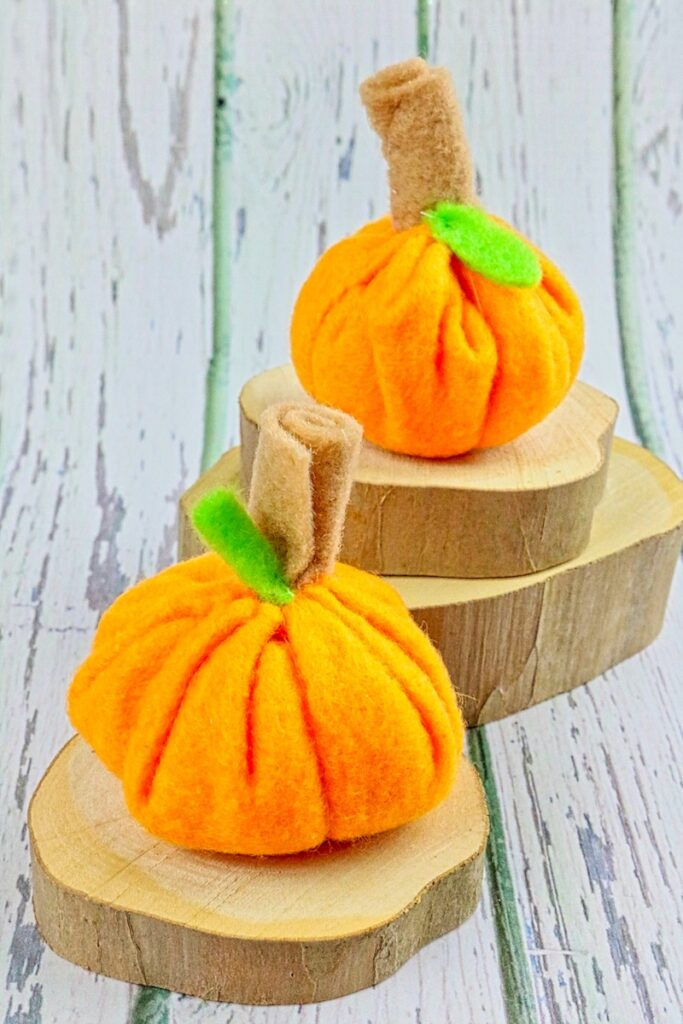 felt mini pumpkins on wood slices