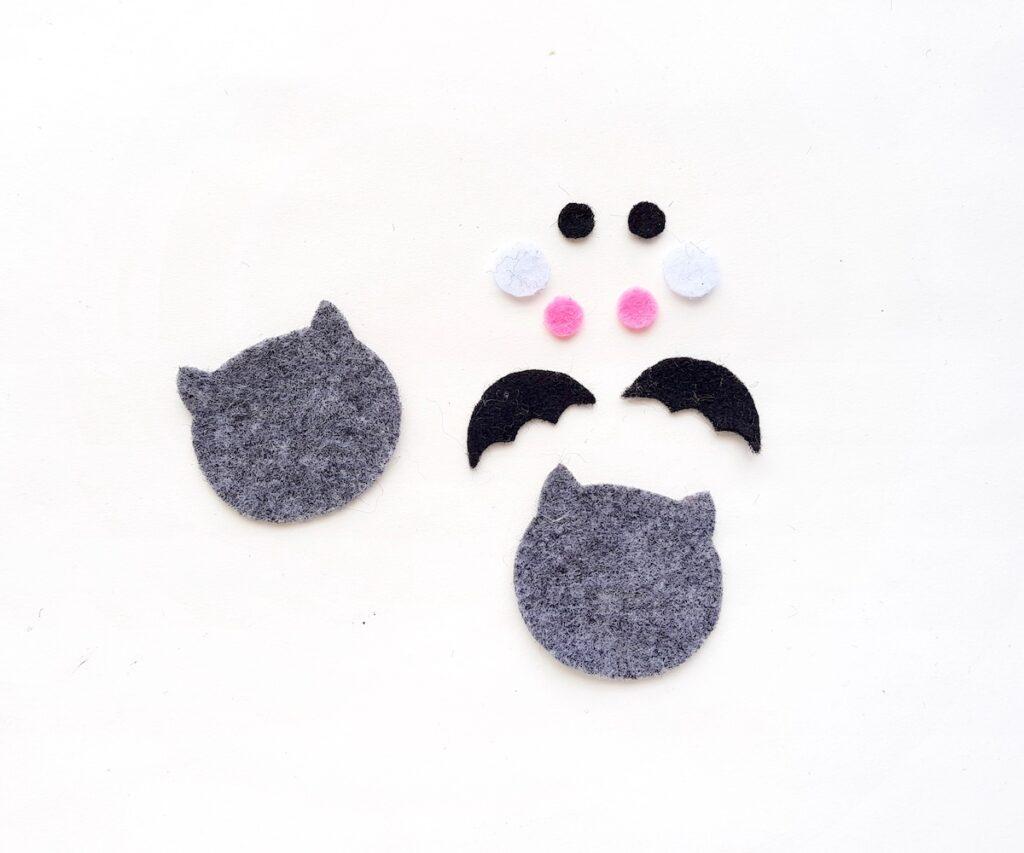 cutouts of a grey plush felt halloween bat toy