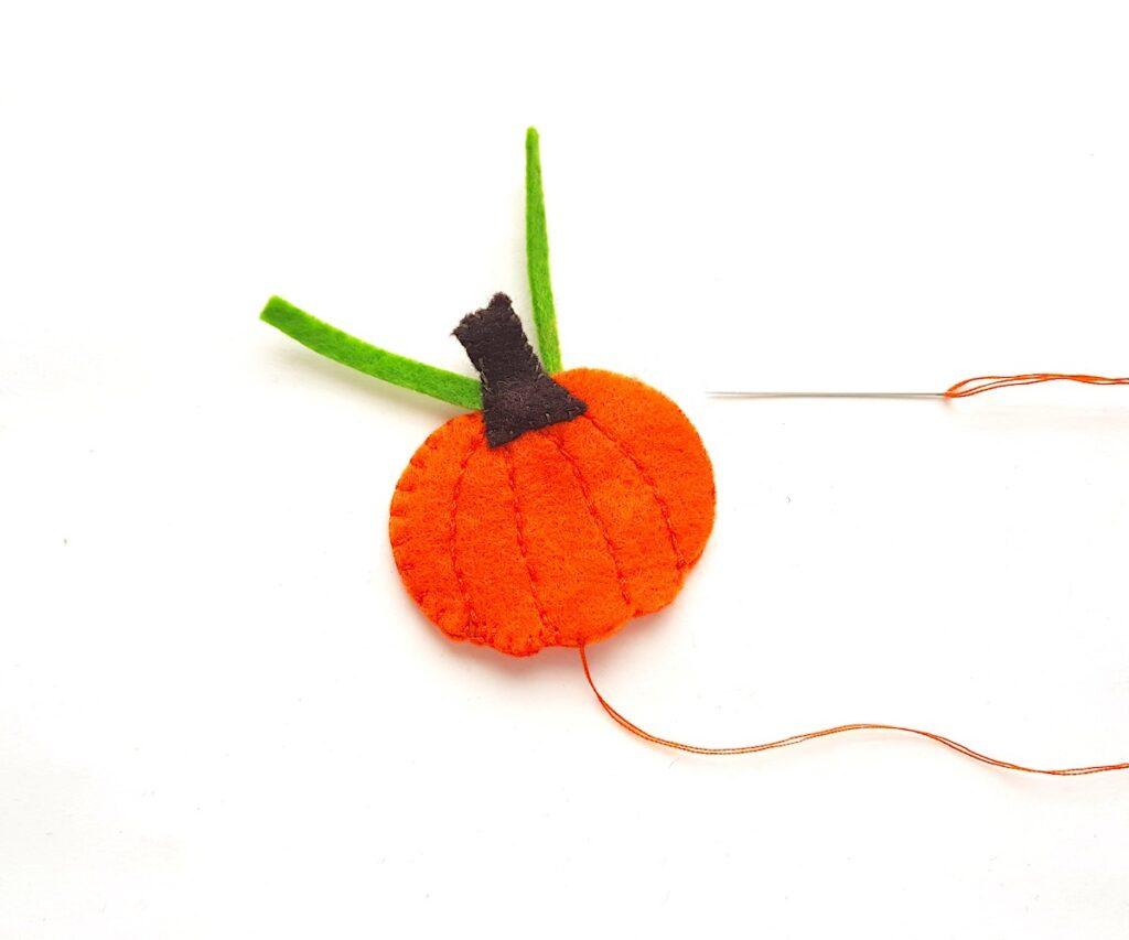 Cute Felt Pumpkin Plush sewing cutouts together