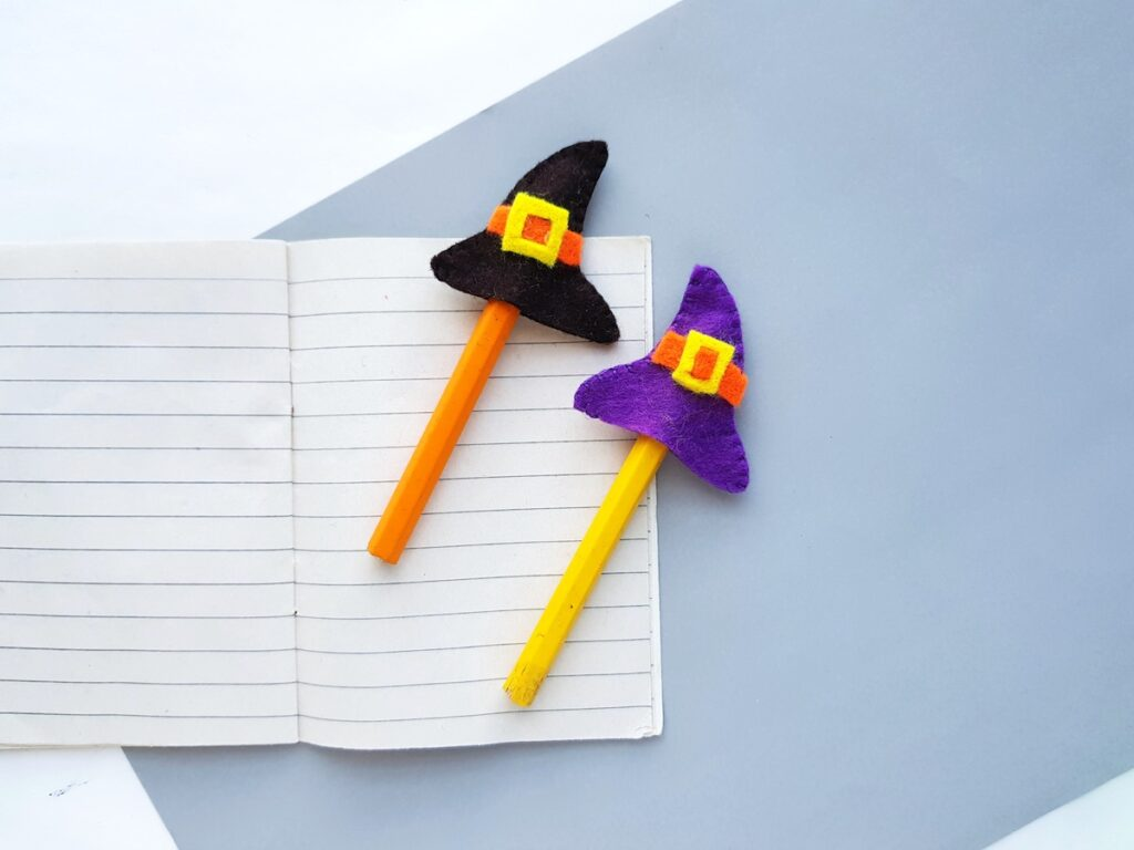 DIY mini felt witch hat pencil toppers on tablet