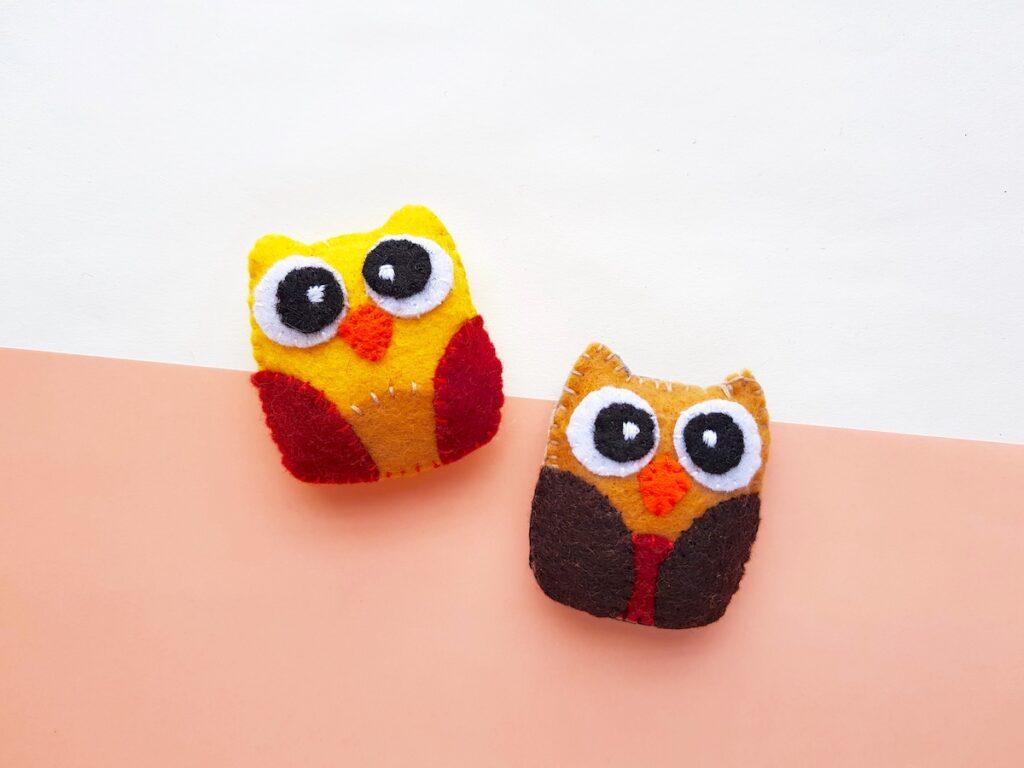 Felt Owl Plush closeup of two color schemes