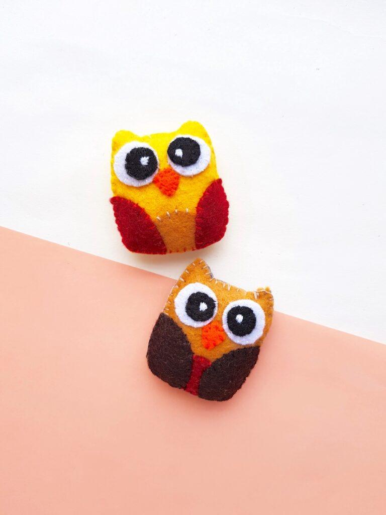 Felt Owl Plush multiple color schemes on peach background