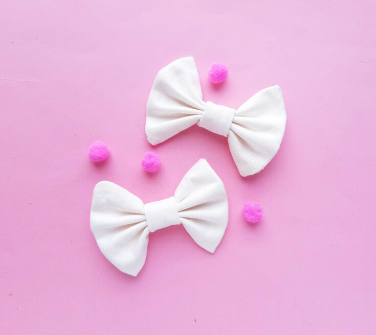 two white bows on pink background