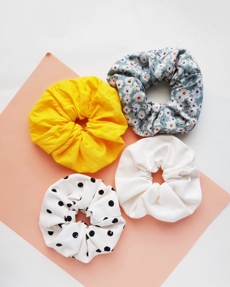 four hair scrunchies made from fabric