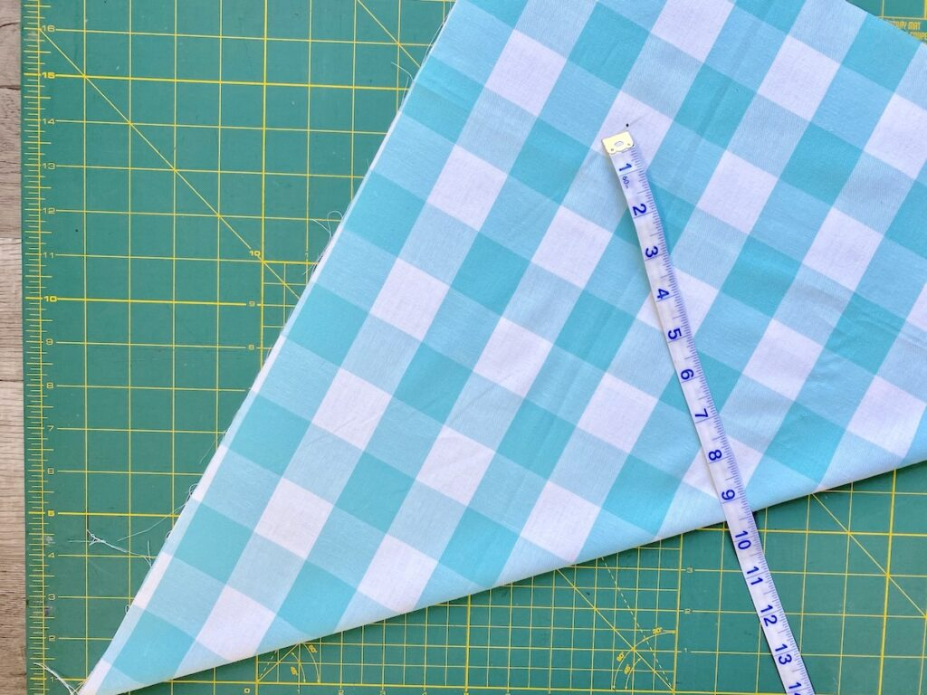 Measuring fabric on cutting mat
