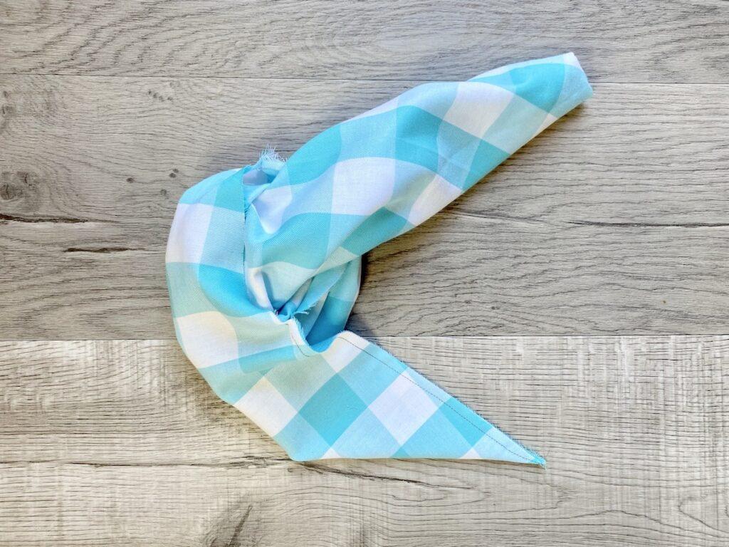 Dog bandana step 5 overhead on grey background