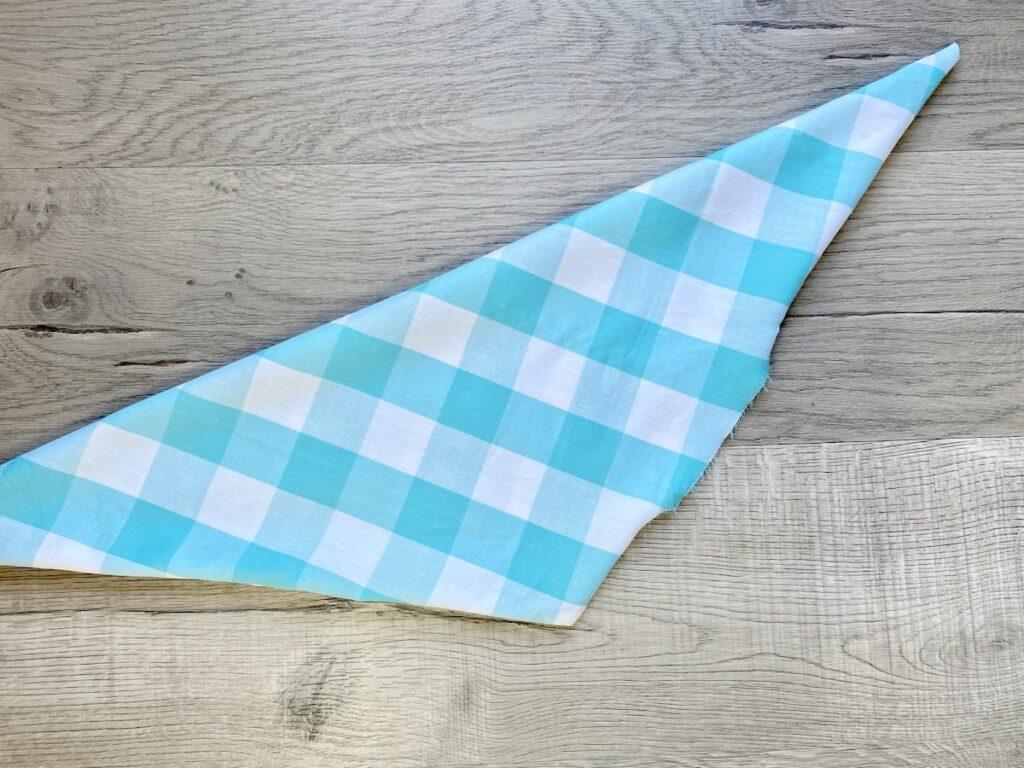 blue and white check dog bandana on wood background