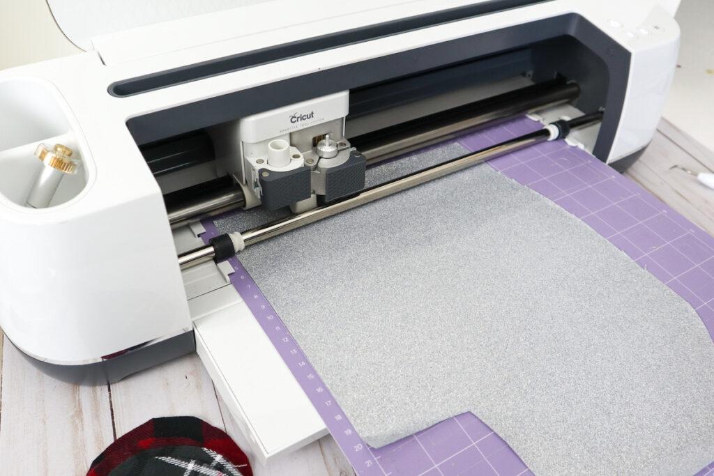 silver glitter vinyl sheet loaded in Cricut machine