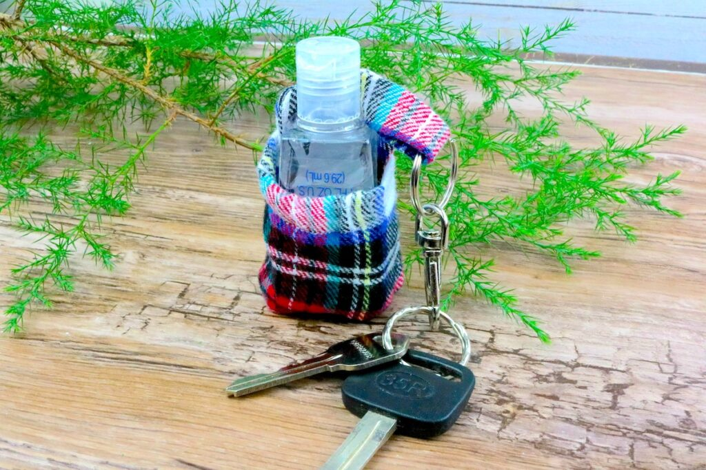 DIY hand sanitizer keychain on wood table