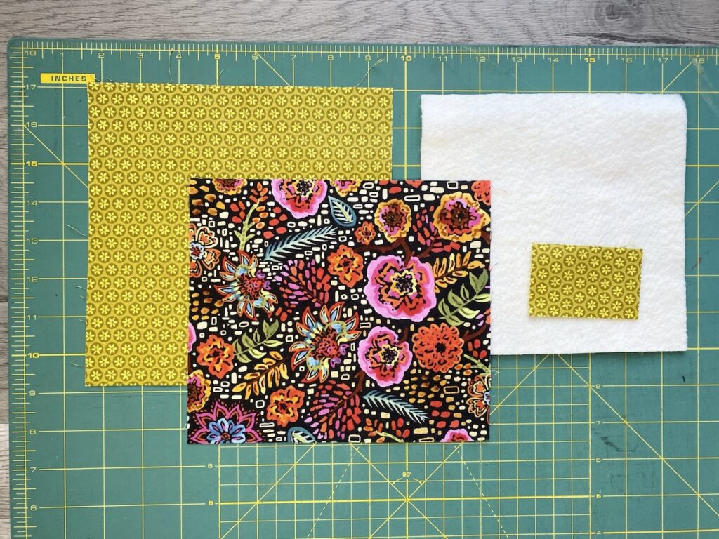 Sunglasses Case Step 1 fabric cut out on cutting board
