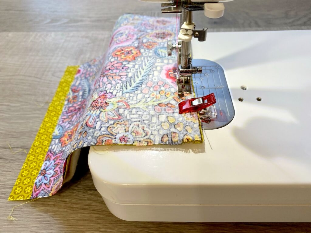 Sunglasses Case Step 3 fabric being sewn on sewing machine