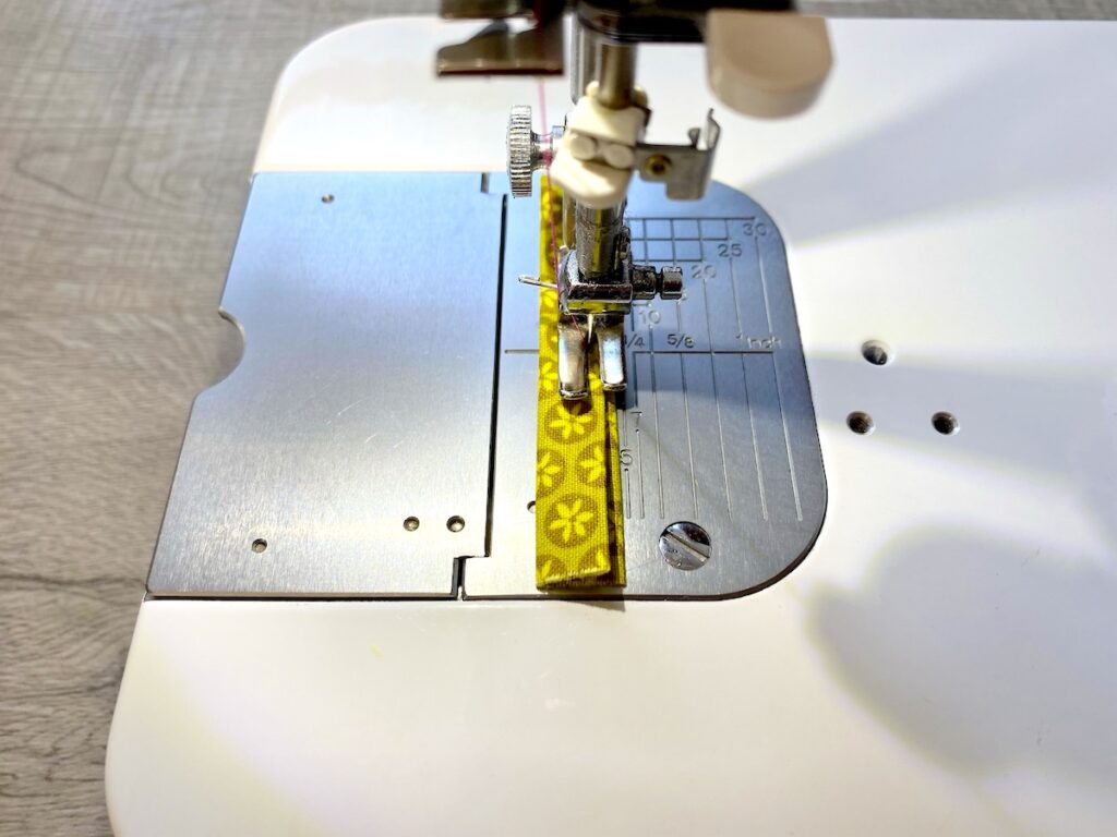 Sunglasses Case Step 6 being sewn on sewing machine