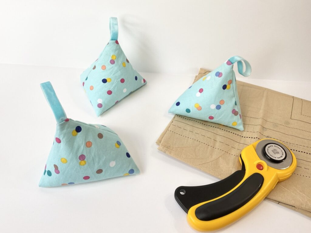 DIY Pattern Weights made from fabric next to sewing pattern