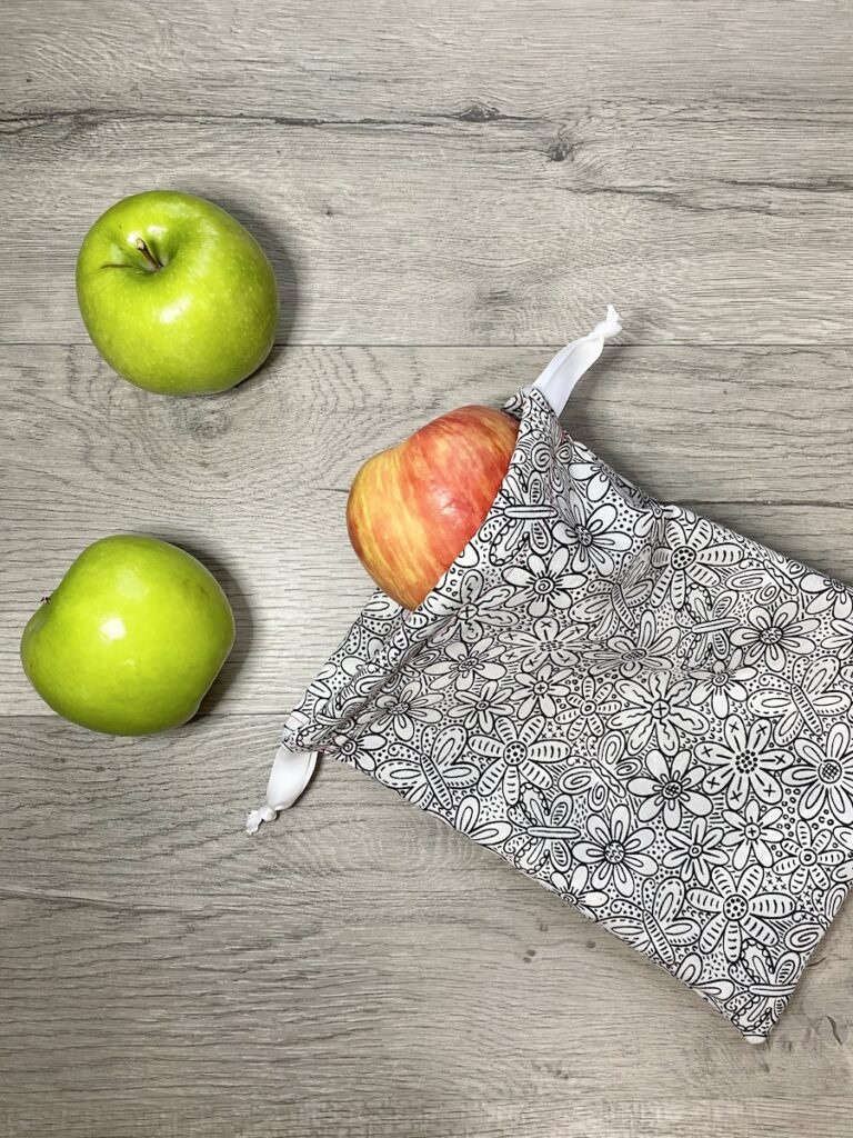 sew a drawstring bag with apples on table