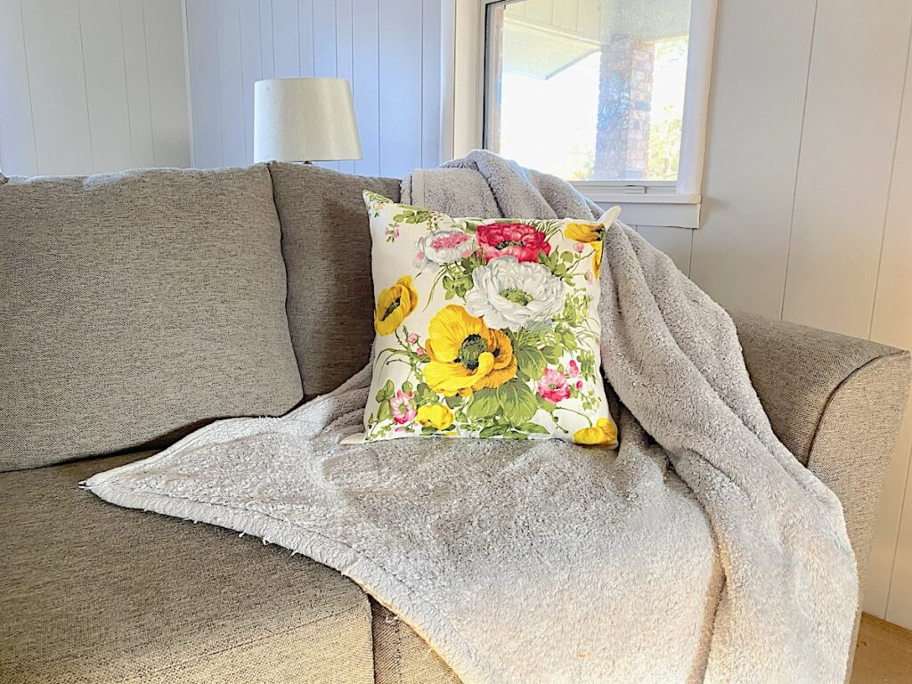 zippered pillow cover on throw and couch