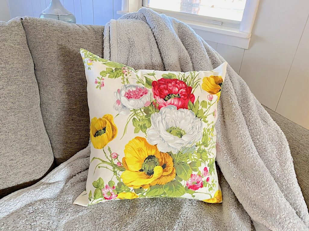 zippered pillow cover on grey couch