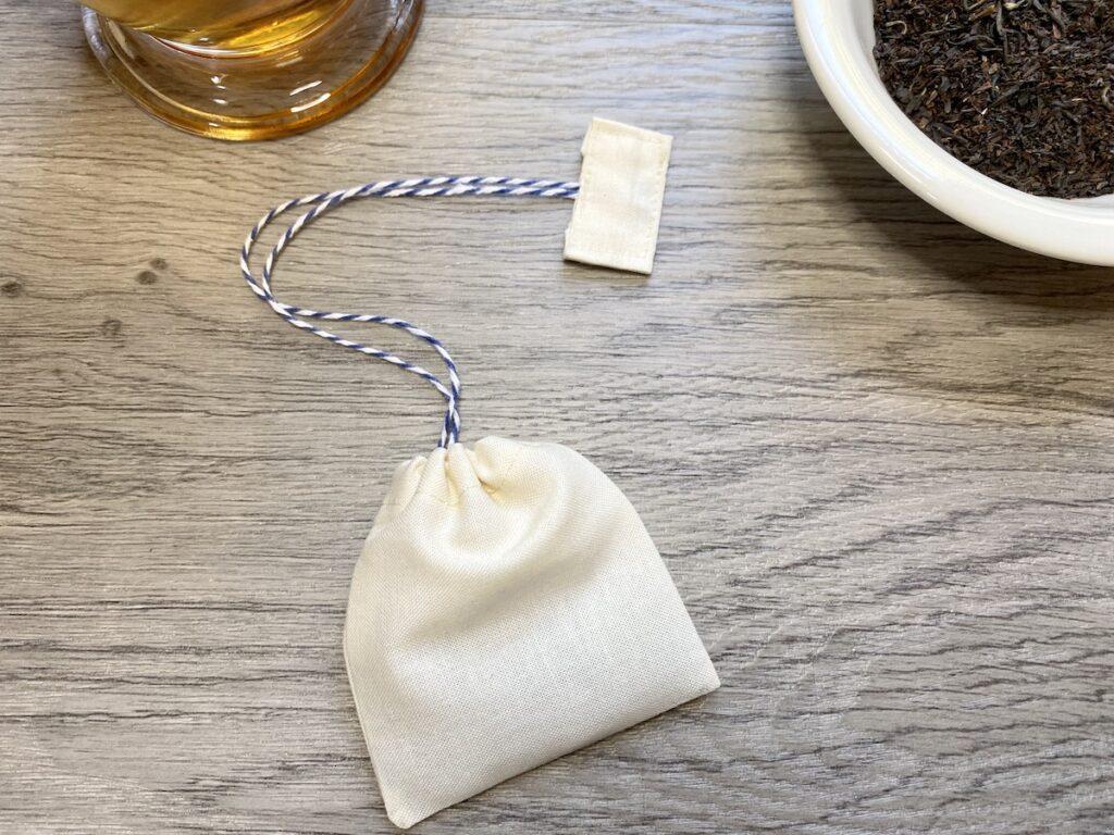 reusable tea bags with glass of tea