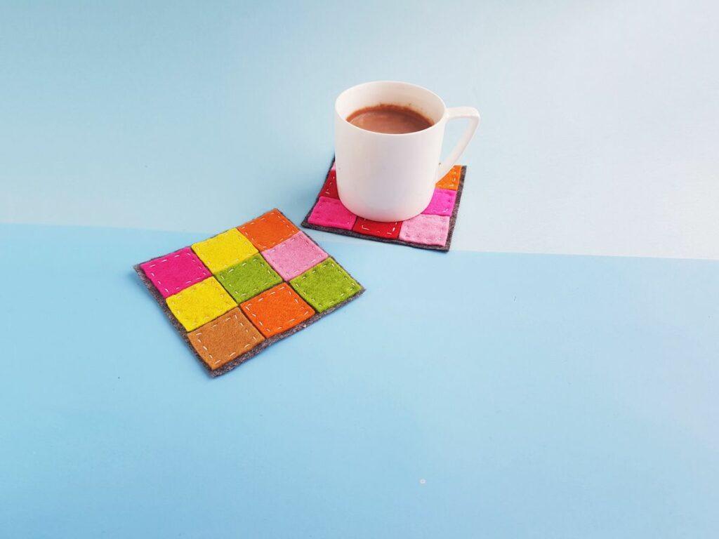 Patchwork Felt Coasters with mug on blue background