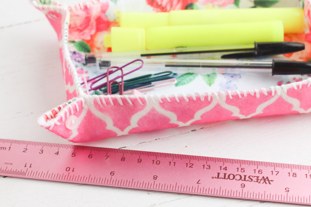 pink ruler next to felt fabric storage tray
